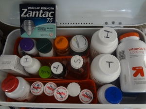 A white box filed with 20 different pill bottles and boxes