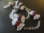 A prayer bead strand with handmade artistan lampwork beads, herkimer diamonds, garnet, and rock quartz.