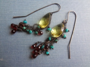 A pair of long-back hook earrings with chain fringe, a lemon quartz briolette, garnets, and turquoise