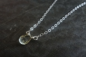 A sterling silver necklace with pale yellow lemon quartz teardrop