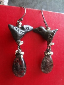 Earrings with 2 black clay birds on top of tiny pearls and black tourmalinated quartz teardrops
