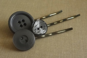 3 bobby pins made with 3 different gray buttons